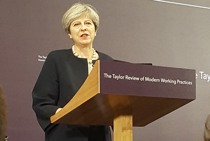 Theresa May speaking at Taylor review launch event