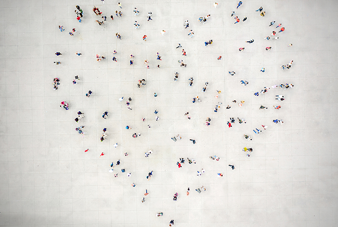 People standing in heart formation